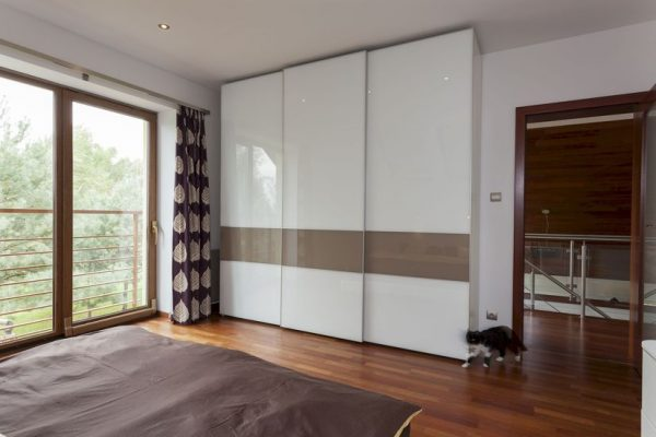 Contemporary bedroom with balcony and huge wardrobe